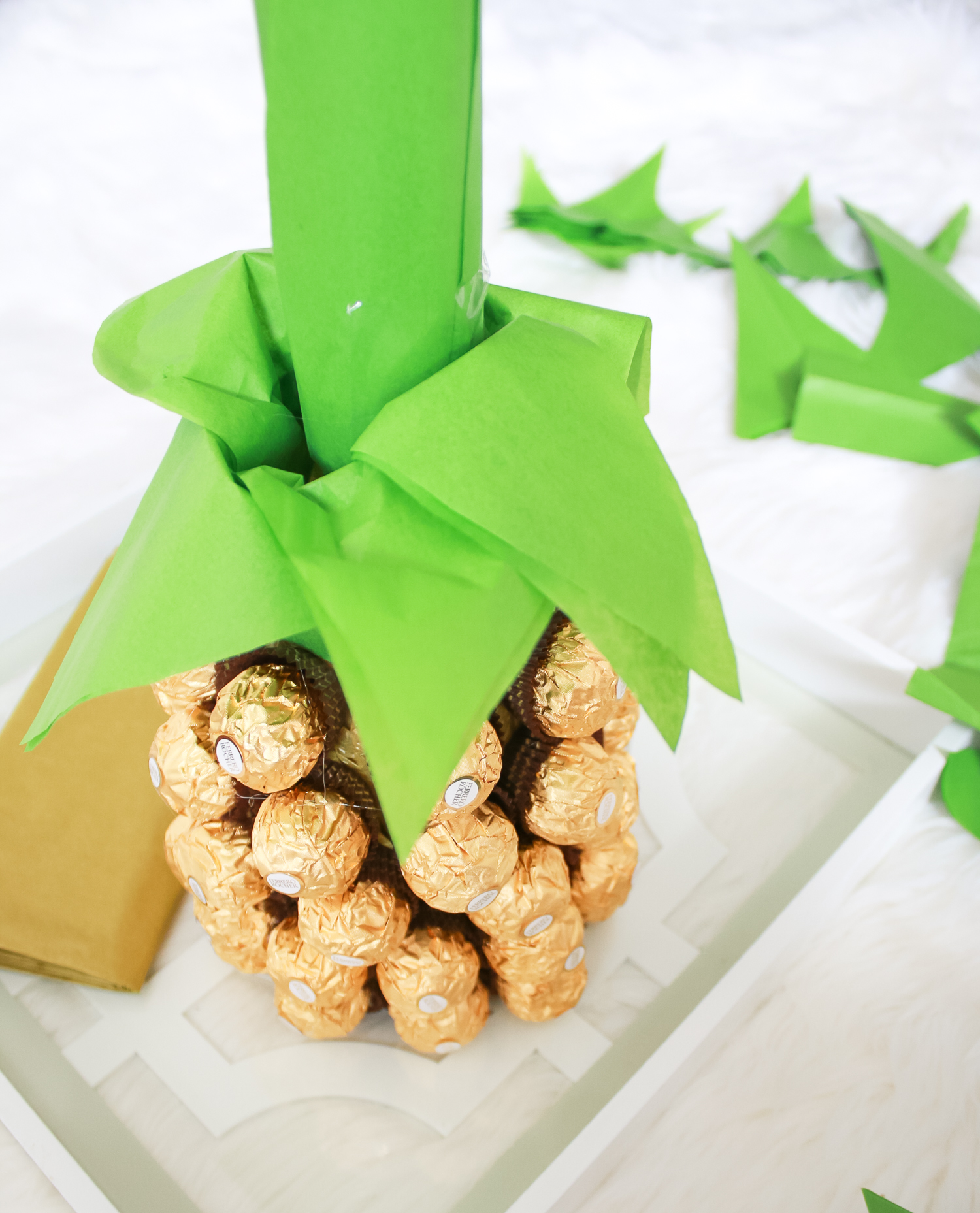 Looking for DIY housewarming gifts? Look no further than this adorable chocolate-covered champagne pineapple by southern blogger Stephanie Ziajka from Diary of a Debutante