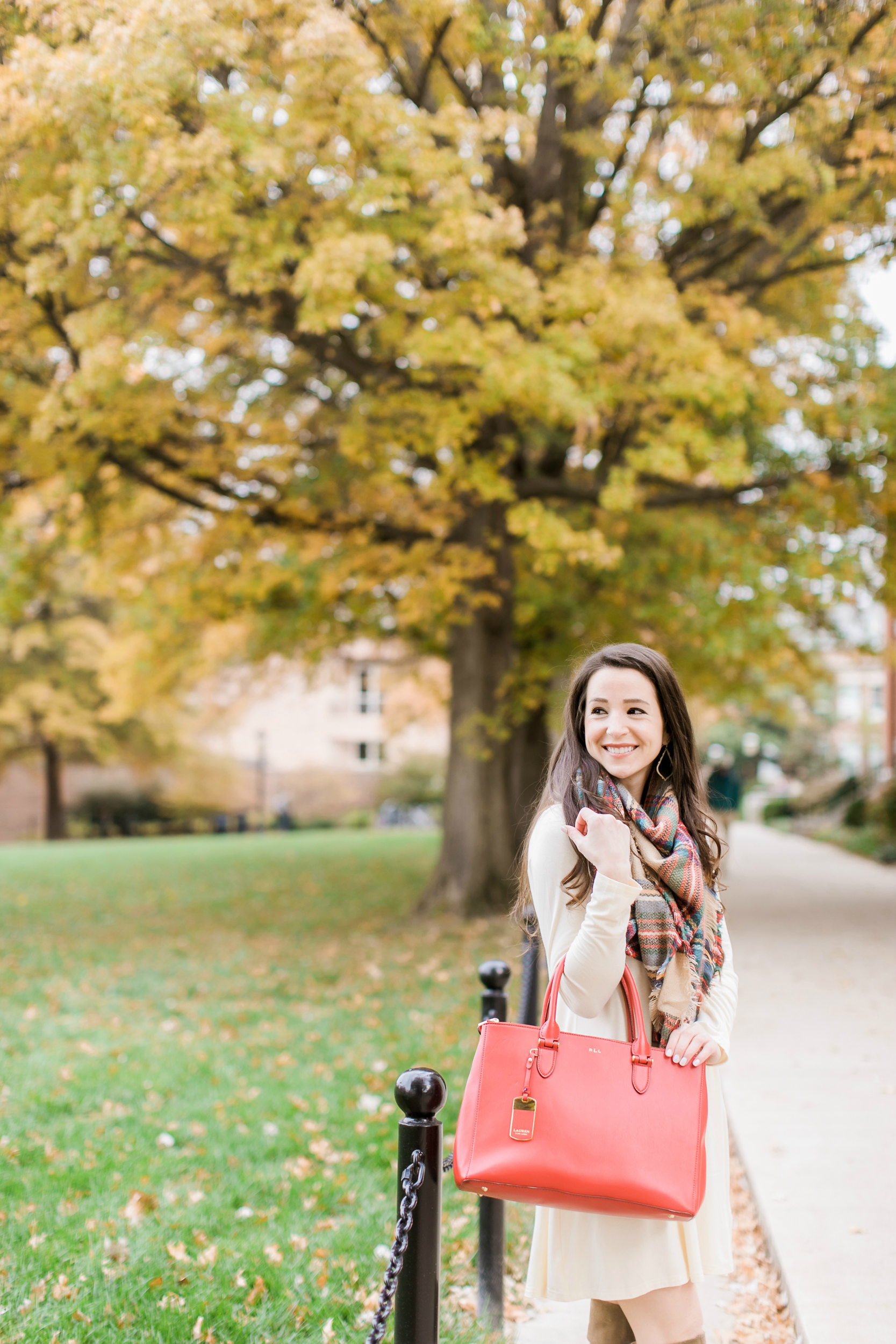 Beige cotton swing dress with tartan blanket scarf, Free People cognac OTK boots, red Ralph Lauren handbag, and Kendra Scott Sophee earrings | Casual holiday outfit idea | 10 tips for looking your best on camera | Tips for Looking Your Best in Holiday Photos from fashion blogger Stephanie Ziajka of Diary of a Debutante