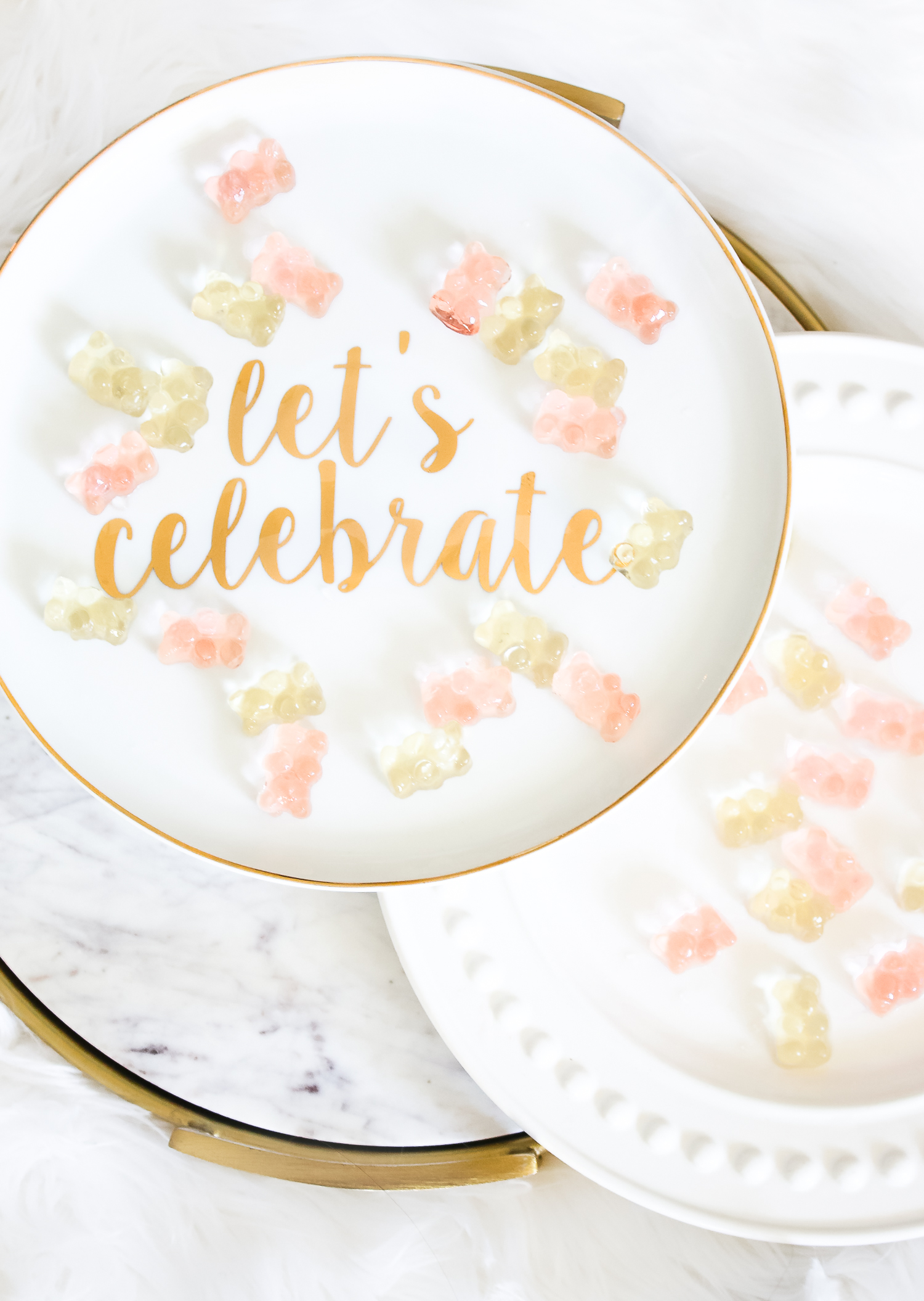 How to make champagne gummy bears by southern lifestyle blogger Stephanie Ziajka from Diary of a Debutante, easy champagne soaked gummy bears recipe using Sugarfina Champagne Bears Gummy Candy, ceramic Let's Celebrate cake stand