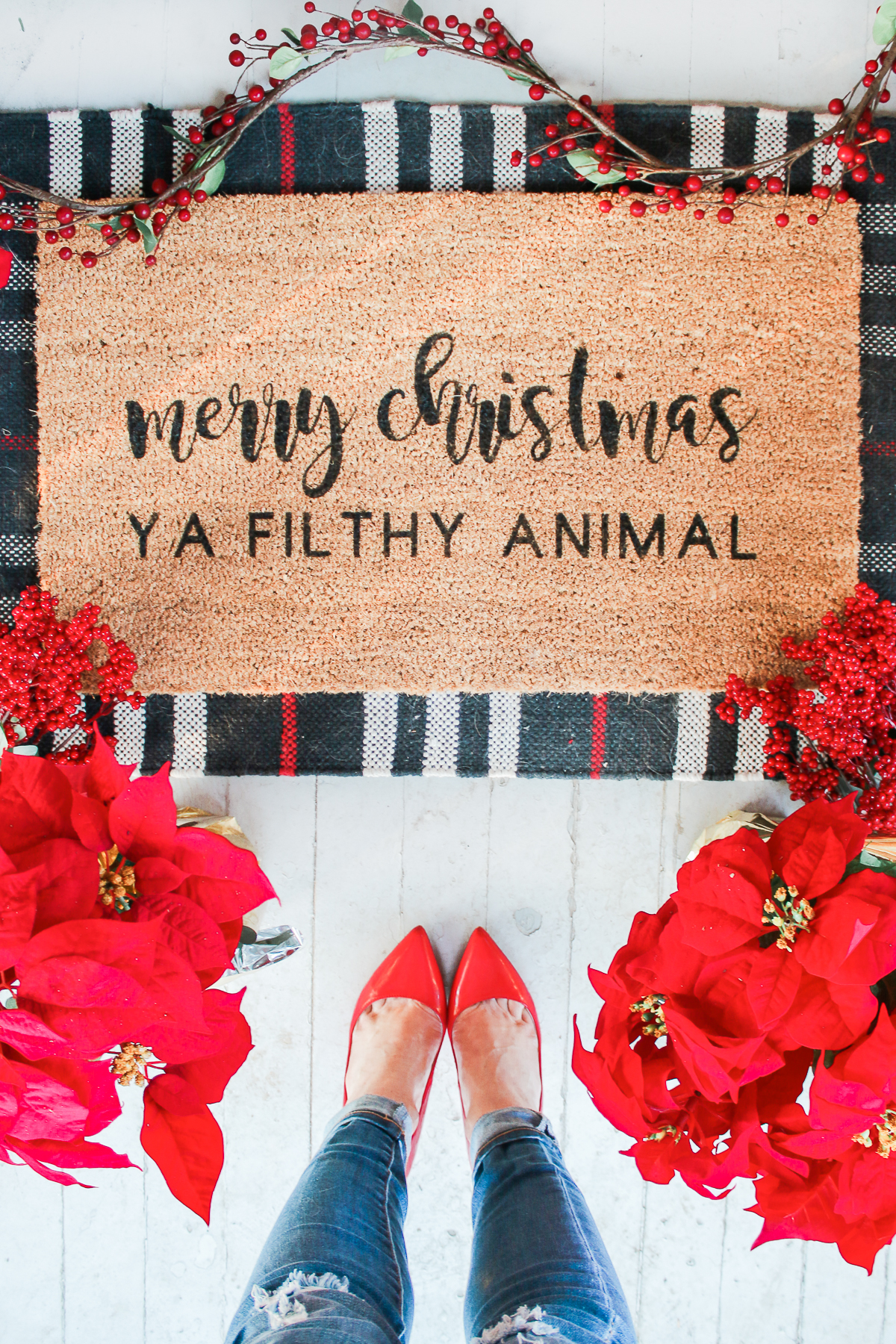"""Merry Christmas Ya Filthy Animal"" DIY Painted Doormat by southern lifestyle blogger Stephanie Ziajka from Diary of a Debutante, DIY doormat stencil with Cricut Explore Air 2, Cricut doormat tutorial, DIY outdoor mat, paint your own doormat tutorial, paint doormat"
