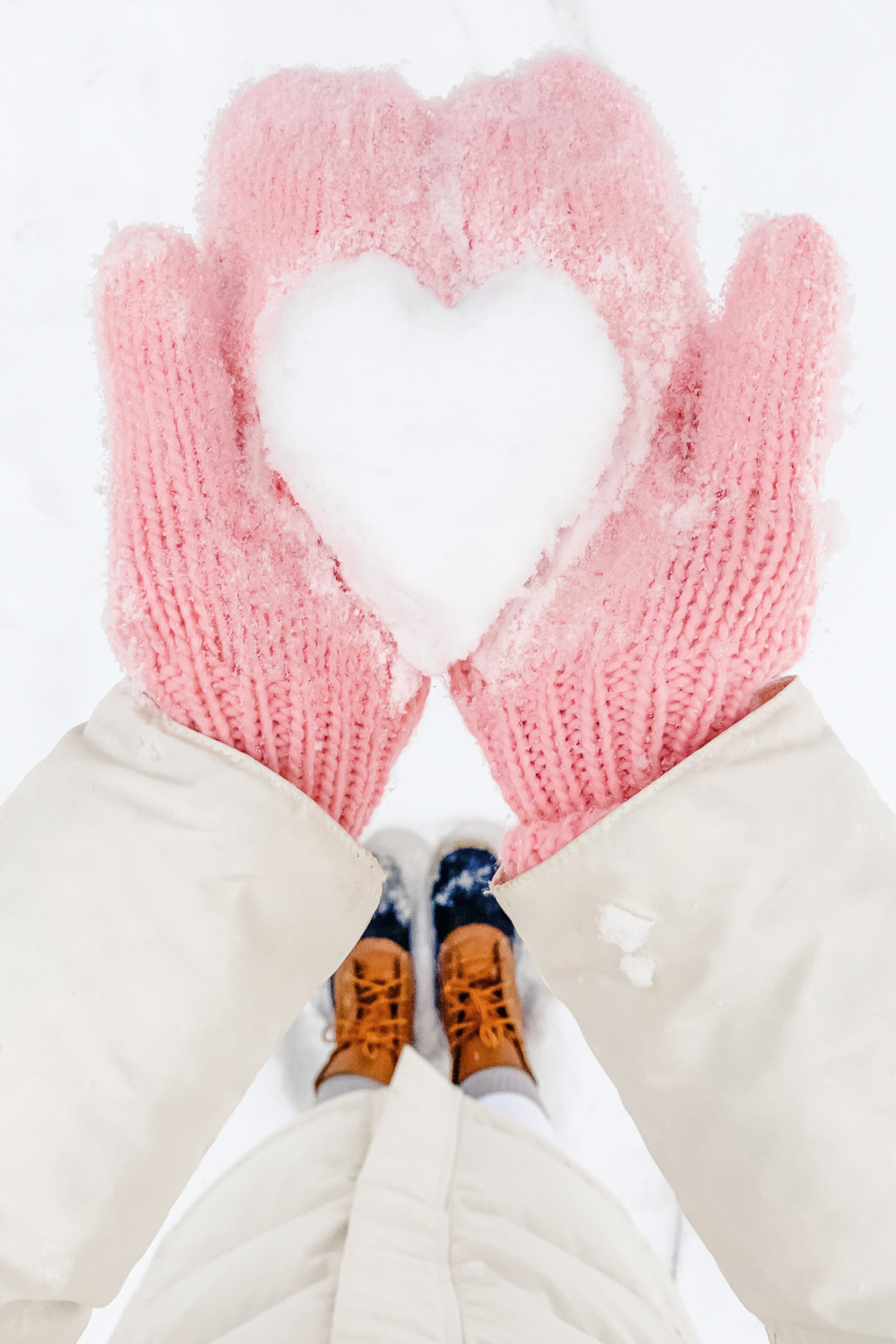 Best of January: 10 Things I Loved in January 2019 by popular affordable fashion and southern lifestyle blogger Stephanie Ziajka from Diary of a Debutante, heart shaped snowball picture, cute heart snowball in mittens picture