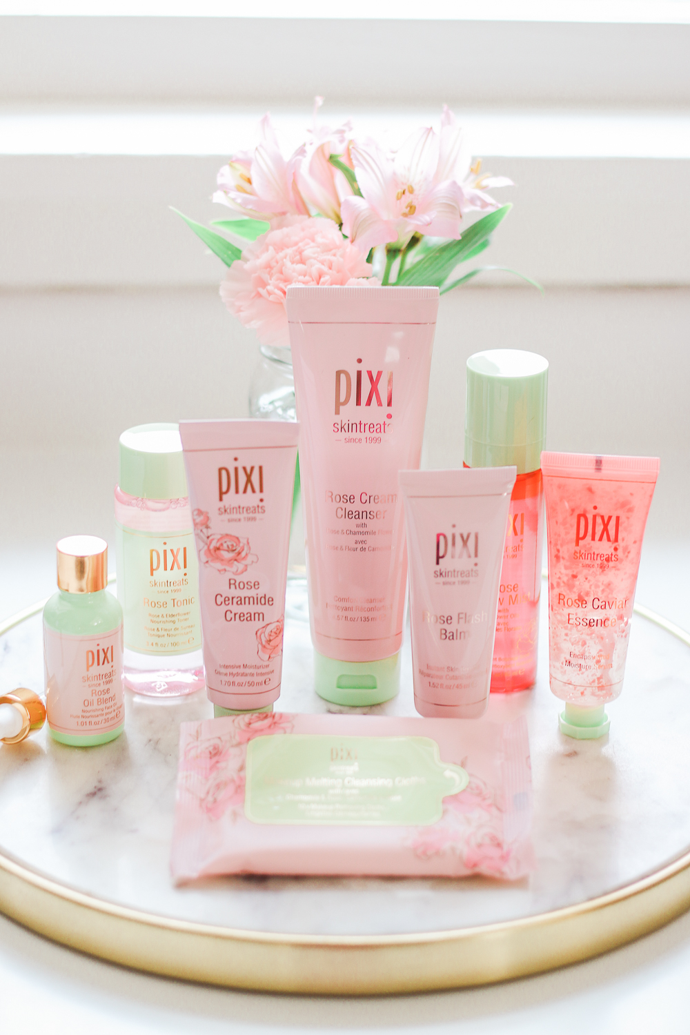 Rose-Infused Skincare Picks: Best Pixi Products for Dry Sensitive Skin by drugstore beauty blogger Stephanie Ziajka from Diary of a Debutante, best of Pixi rose infused skincare, pixi rose infused skintreats, best pixi skincare products, pixi rose oil blend review, pixi by petra rose oil blend, pixi products review, pixi rose cream cleanser review, pixi rose ceramid cream review, pixi rose caviar essence review, pixi rose flash balm review, pixi makeup melting cleansing cloths review, pixi rose glow mist review
