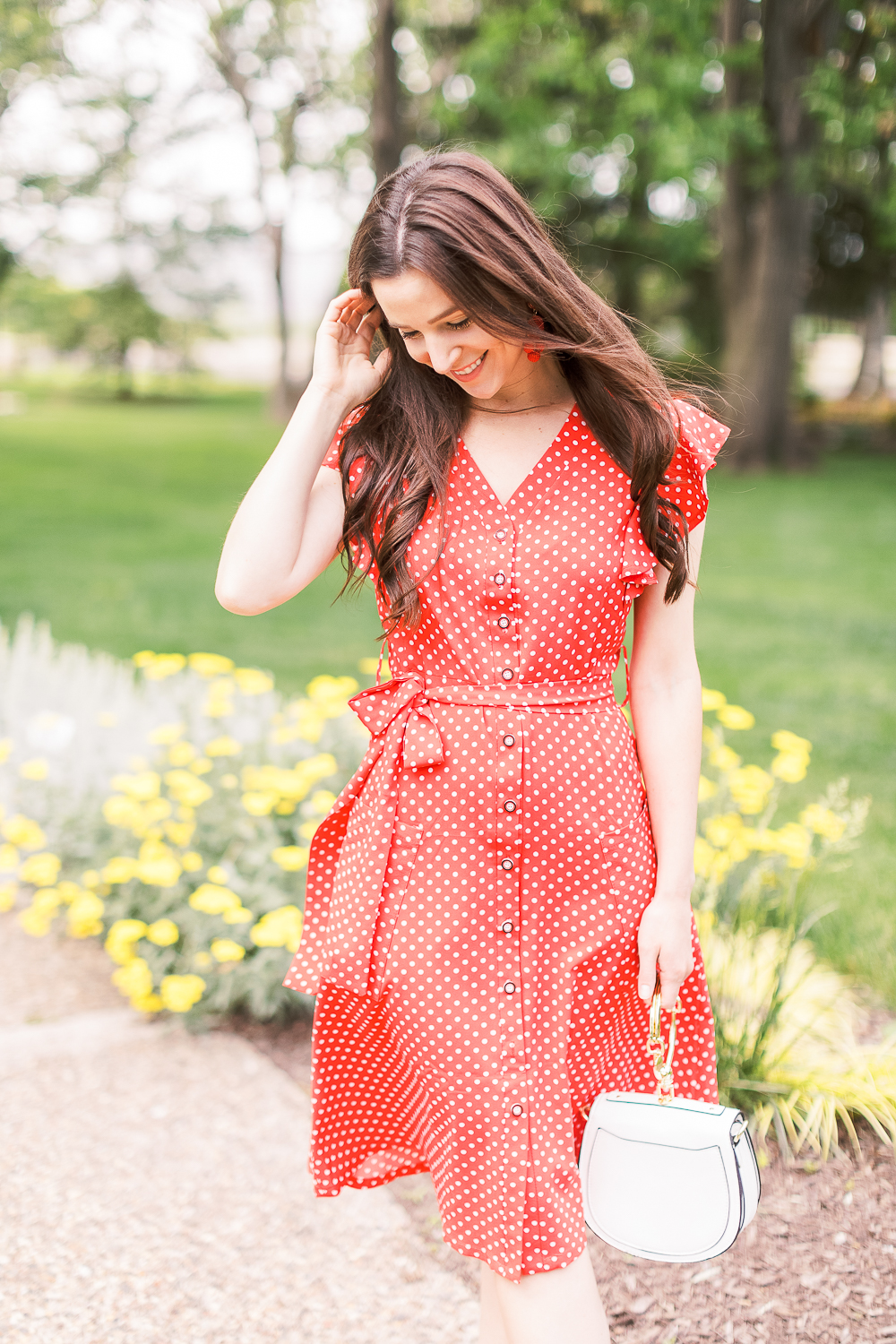 4th of July Outfit Idea: Red Polka Dot Midi Dress Outfit by popular affordable style blogger Stephanie Ziajka on Diary of a Debutante, MITILLY Polka Dot Sleeveless V Neck Swing Midi Dress with Pockets, white Chloe Nile dupe bag, A New Day Women's Adelina Espadrilles Slide Sandals