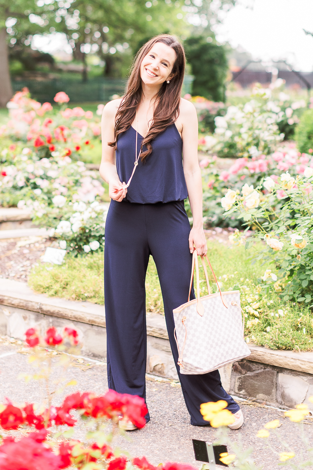 Navy jumpsuit outfit, 10 Preppy 4th of July Outfit Ideas for Women by popular affordable fashion blogger Stephanie Ziajka from Diary of a Debutante