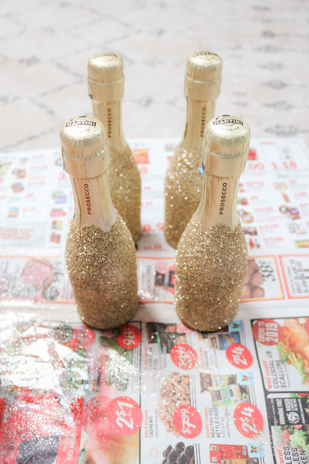 how to decorate alcohol bottles with glitter, mini glitter bottle diy tutorial, popular diy blogger Stephanie Ziajka, popular DIY blog Diary of a Debutante