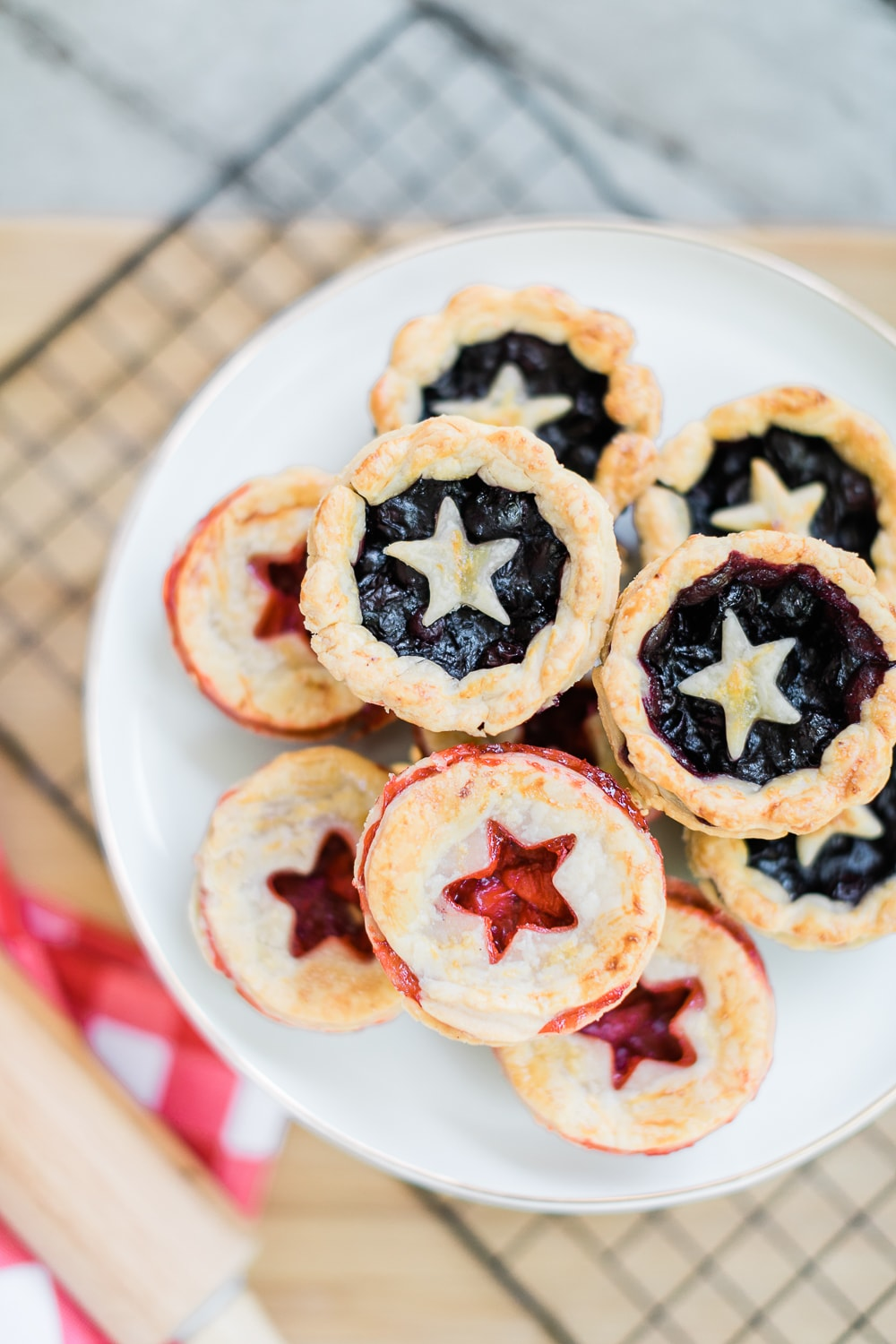 Patriotic mini strawberry and blueberry pies by blogger Stephanie Ziajka on Diary of a Debutante