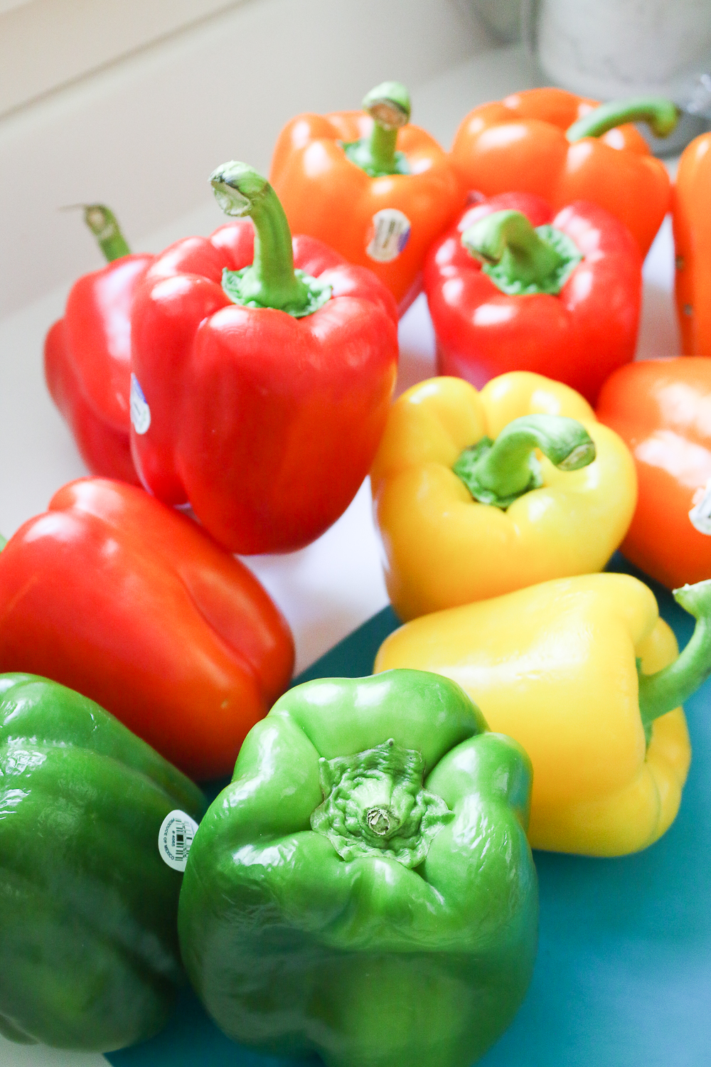 Fresh red, yellow, orange, and green bell peppers to be used for skewering on Diary of a Debutante