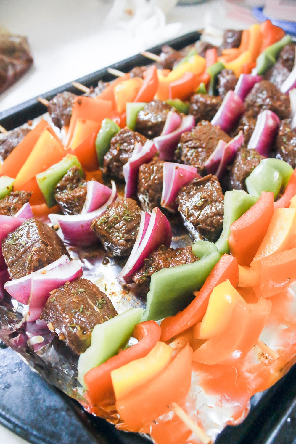 Blogger Stephanie Ziajka shows step three of how to make beef kabobs in the oven on Diary of a Debutante