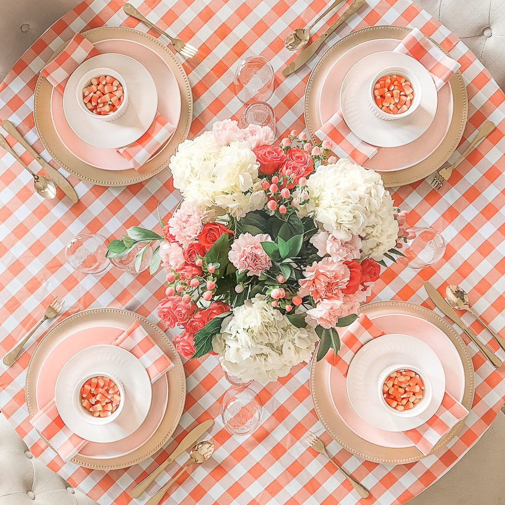 Pink and orange Halloween table decor ideas by southern lifestyle blogger Stephanie Ziajka on Diary of a Debutante