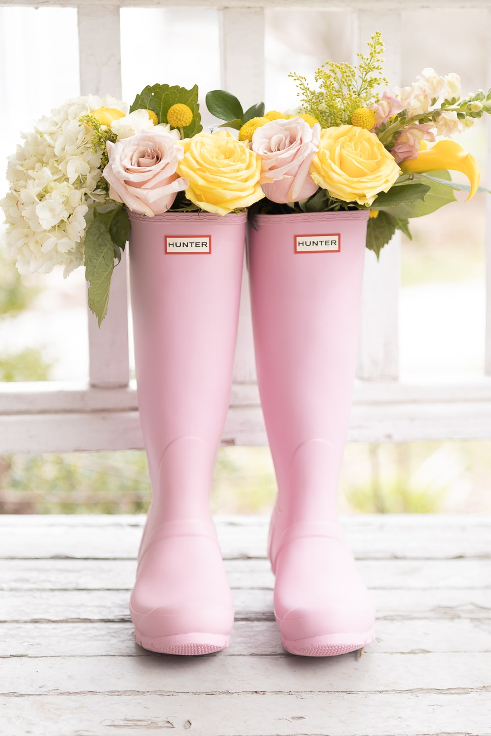 Blogger Stephanie Ziajka shares pink Hunter Boots filled with flowers, along with tips on how to clean Hunter Boots and a Hunter Boot sizing guide, on Diary of a Debutante