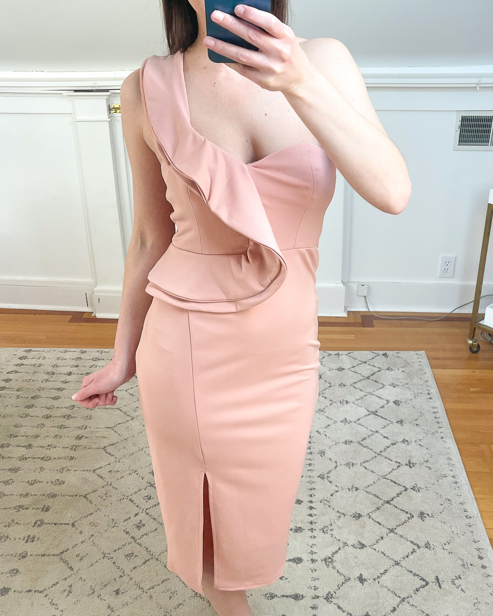 Affordable fashion blogger Stephanie Ziajka shares why this pink ruffle dress is one of her favorite Amazon spring fashion finds under 50 on Diary of a Debutante
