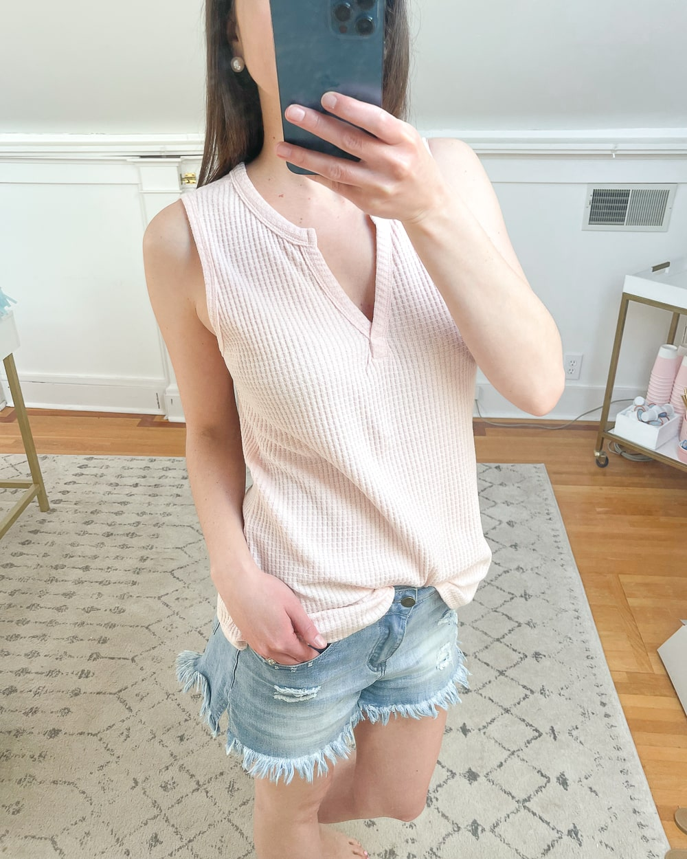 As part of an affordable Amazon try on haul, affordable fashion blogger Stephanie Ziajka shares a detail shot of her casual pink Amazon waffle knit shirt on Diary of a Debutante