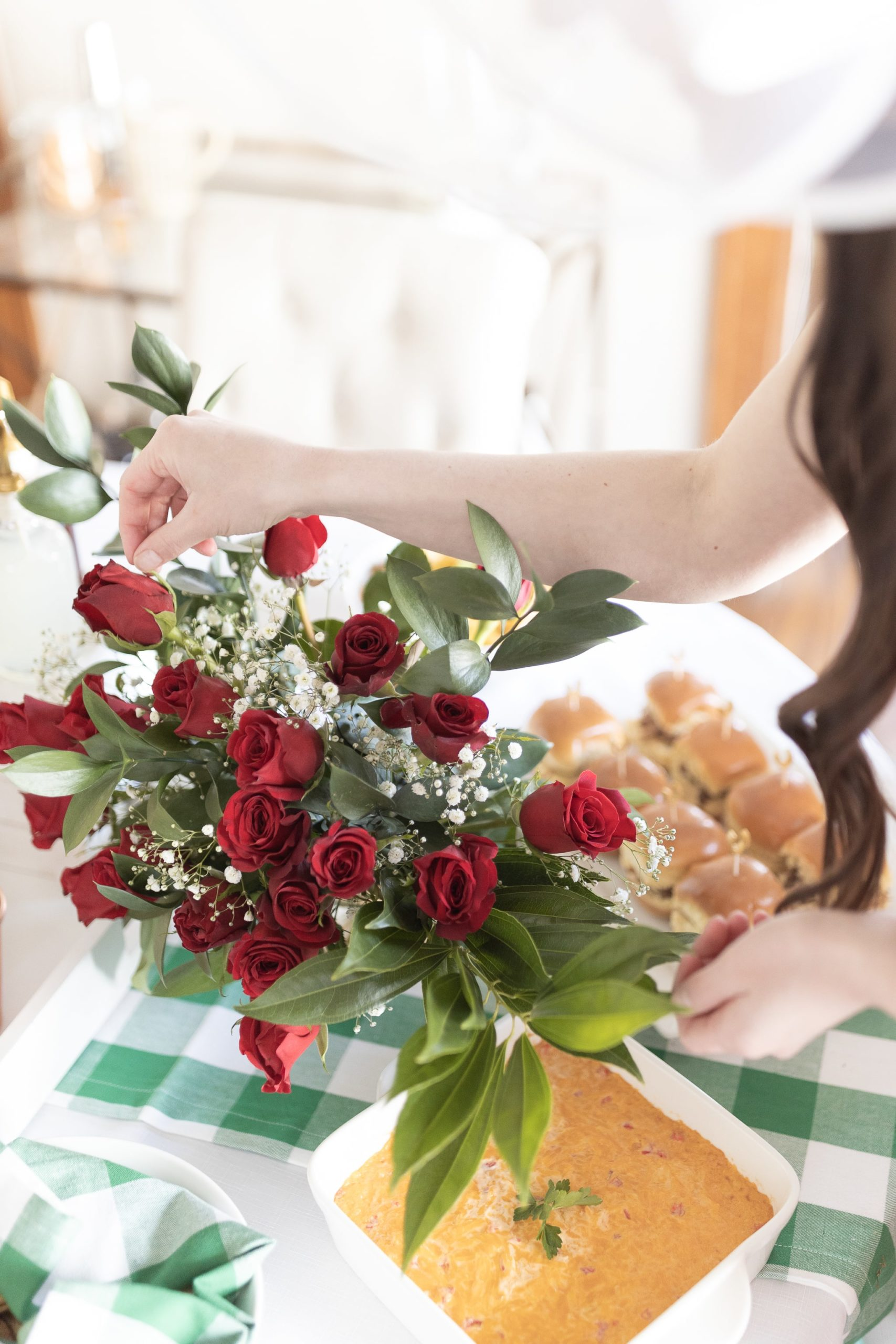 Red rose Kentucky Derby table decorations designed by blogger Stephanie Ziajka on Diary of a Debutante