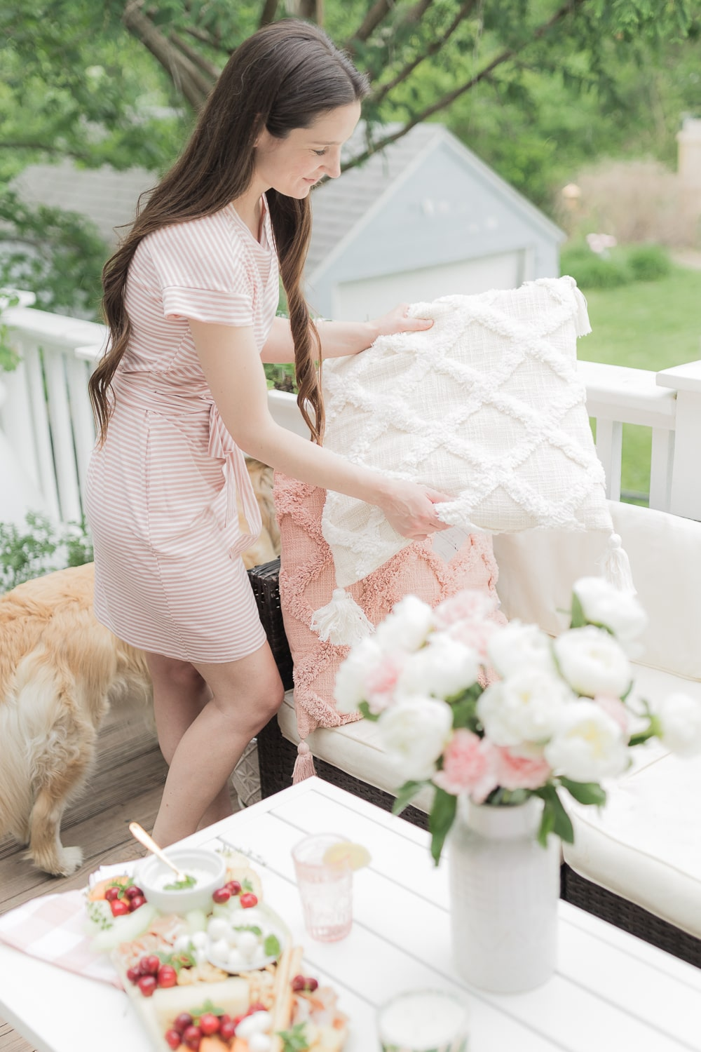 Blogger Stephanie Ziajka shares why these Walmart tufted trellis pillows are one of her top summer entertaining essentials from Walmart on Diary of a Debutante