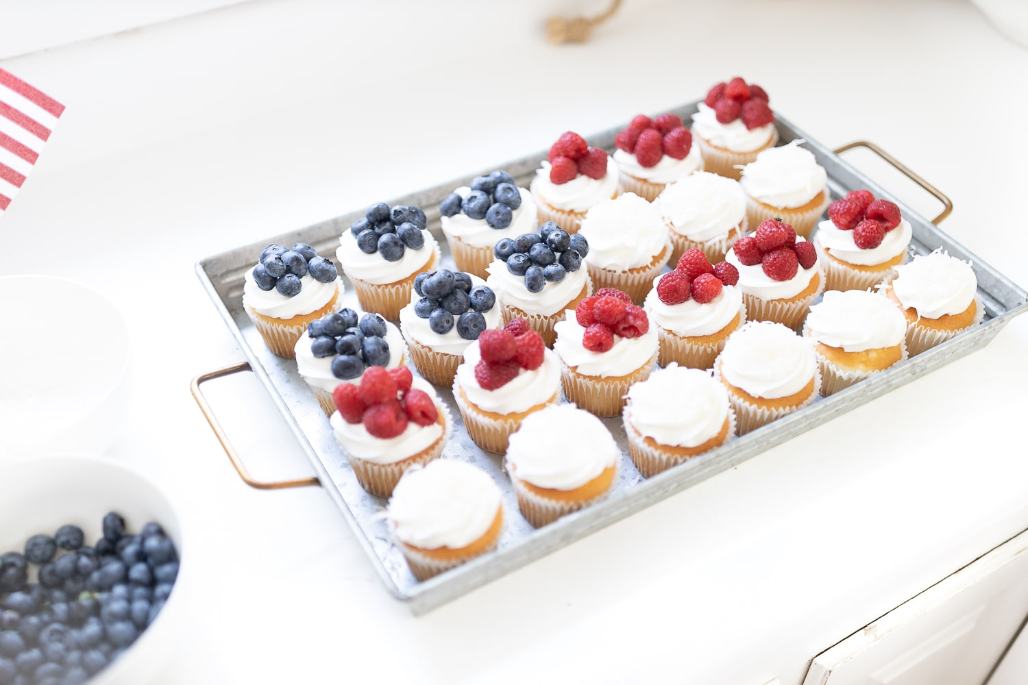American flag dessert tray created with plain vanilla cupcakes and red, white, and blue fruit by entertaining blogger Stephanie Ziajka on Diary of a Debutante