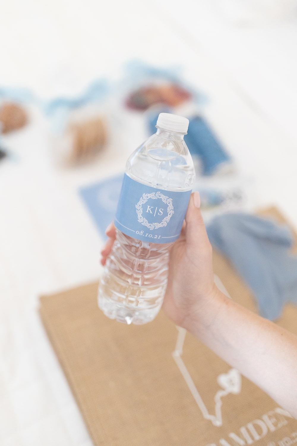 Monogrammed water bottle labels used in blogger Stephanie Ziajka's wedding welcome bags on Diary of a Debutante